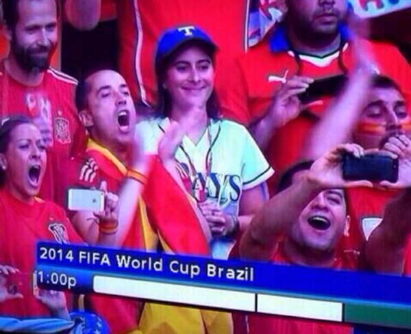 a baseball fan at a world cup game