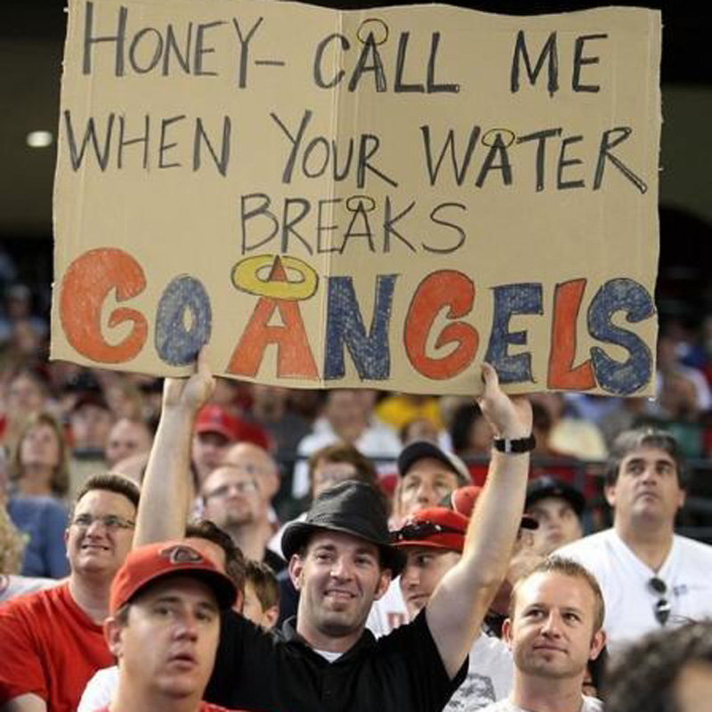 an angels fan with a sign for his wife