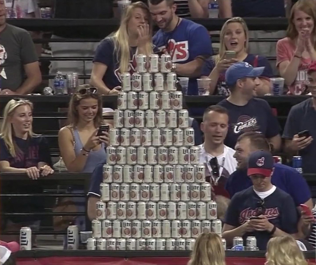 fans build a beer wall at a baseball game