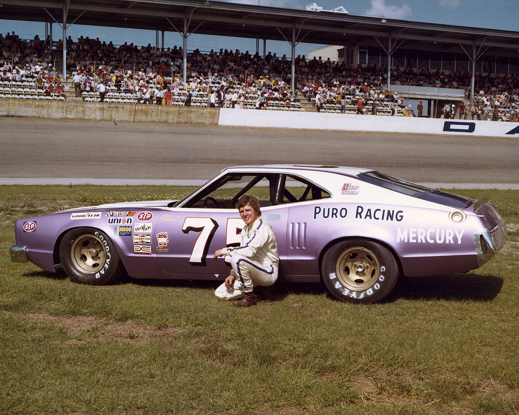 Dick Trickle poses with his Delbert Puro-owned NASCAR Cup Mercury