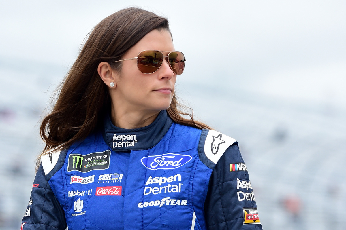 Danica Patrick wearing sunglasses on the track