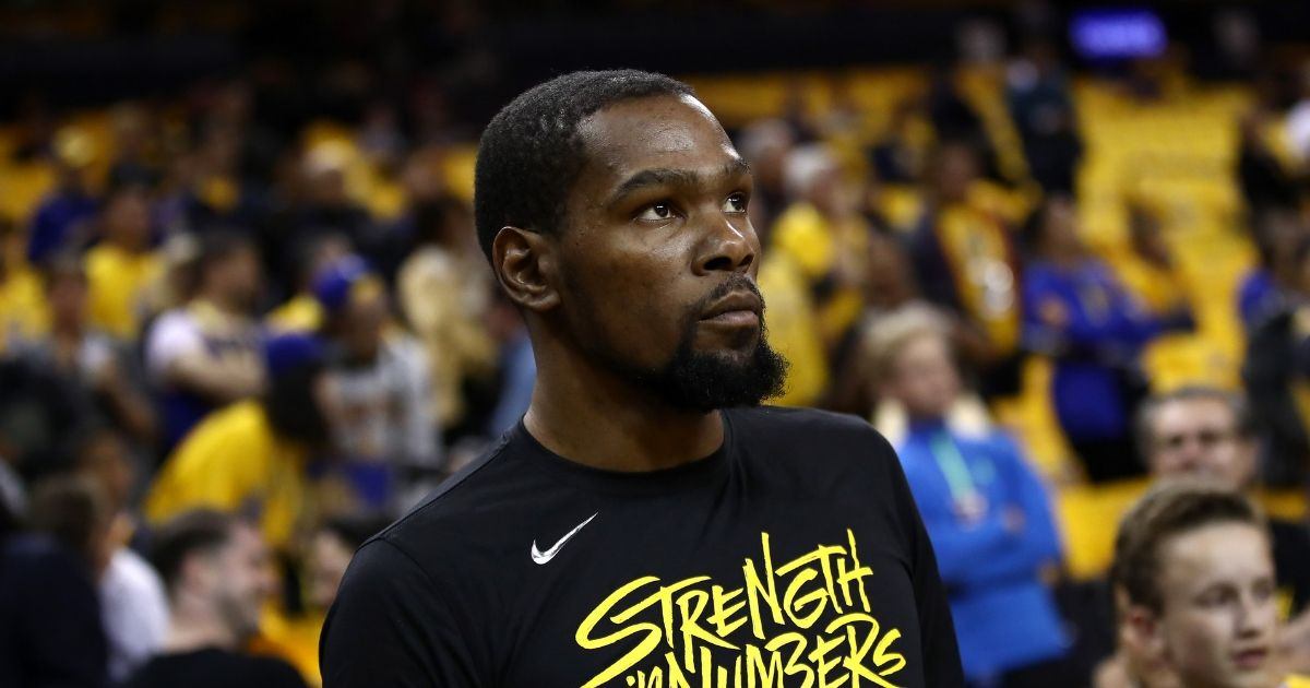 Kevin Durant on the court during warm up before a basketball game