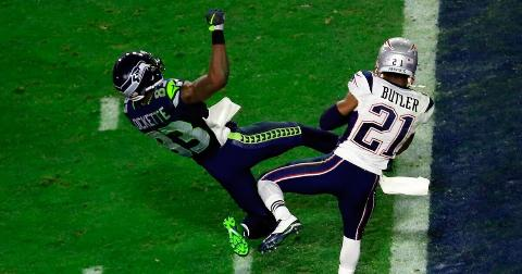 Malcolm Butler of the New England Patriots intercepts a pass by Russell Wilson of the Seattle Seahawks intended for Ricardo Lockette in the fourth quarter during Super Bowl XLIX  on February 1, 2015