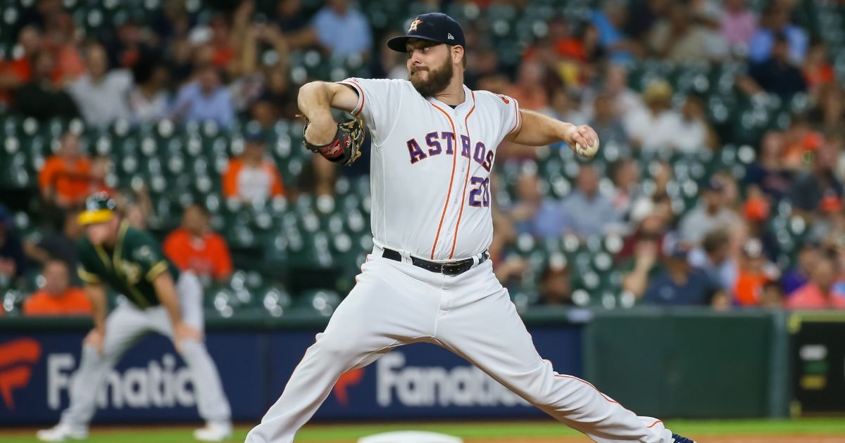 Houston Astros starting pitcher Wade Miley throws a pitch during the baseball game between the Oakland Athletics and Houston Astros