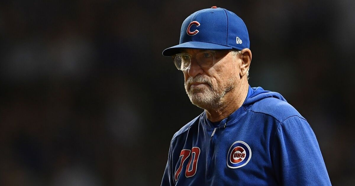 Manager Joe Maddon of the Chicago Cubs walks to the mound during a game