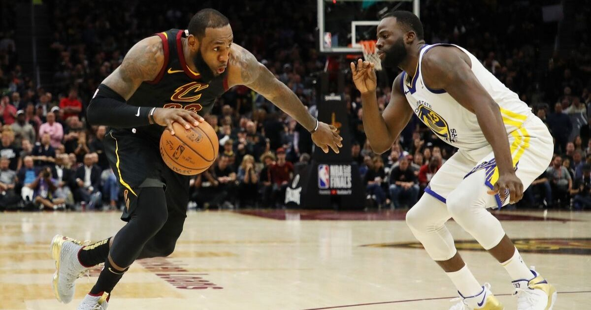 LeBron James drives against Draymond Green during Game Three of the 2018 NBA Finals