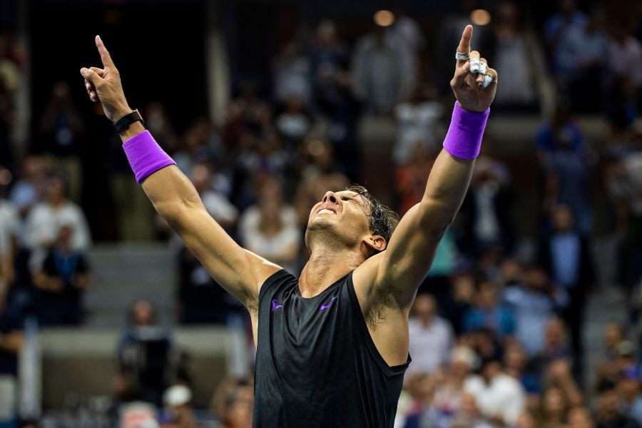 Rafael Nadal celebrates with his arms in the air after winning the US Open