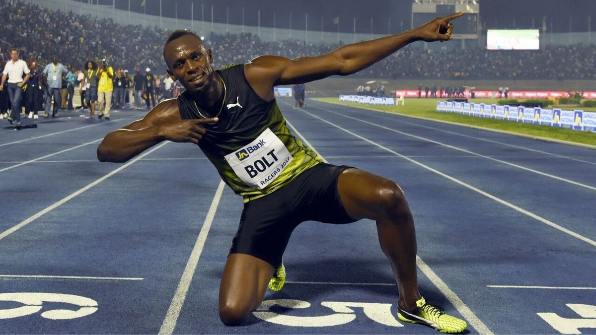 Usain Bolt (C) of Jamaica reacts after winning his final race in home country during the Racers Grand Prix at the national stadium in Kingston, Jamaica, on June 10, 2017.