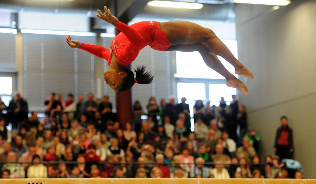 simone biles performing in front of a crowd