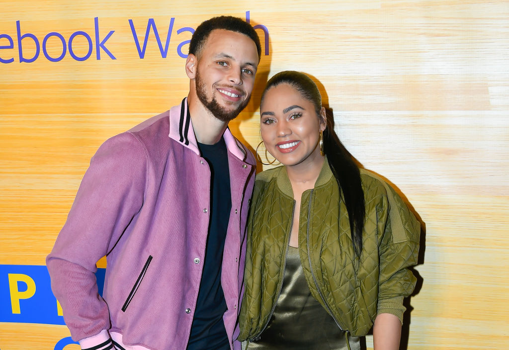 stephen and ayesha curry pose for a photo