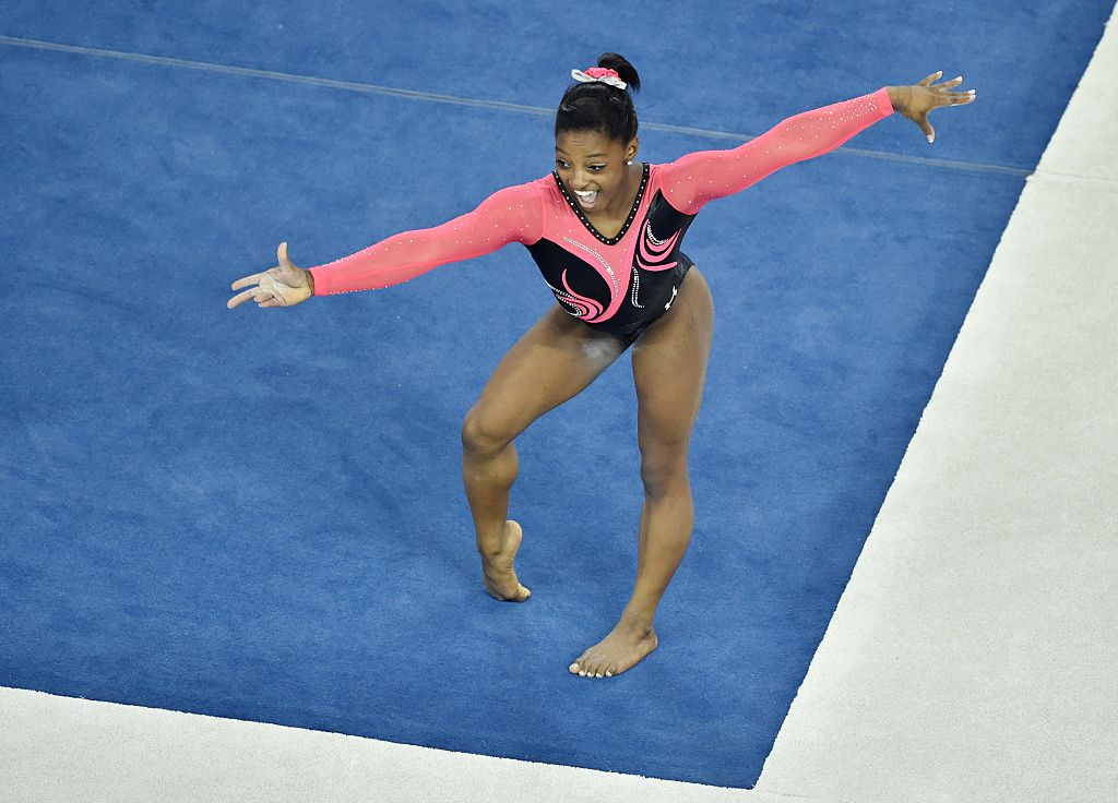 simone biles on the mat