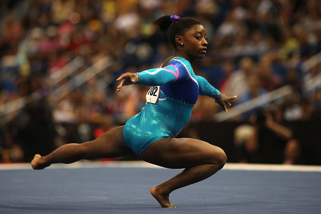 simone biles performing a routine
