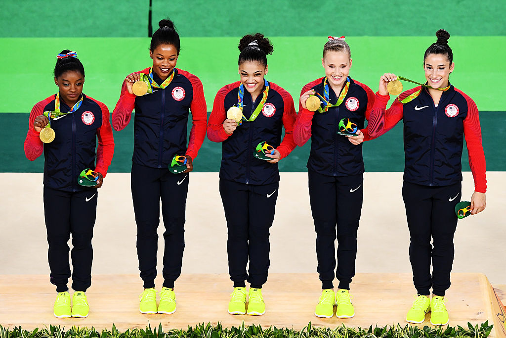 simone biles on the medal stand with fellow gymnasts