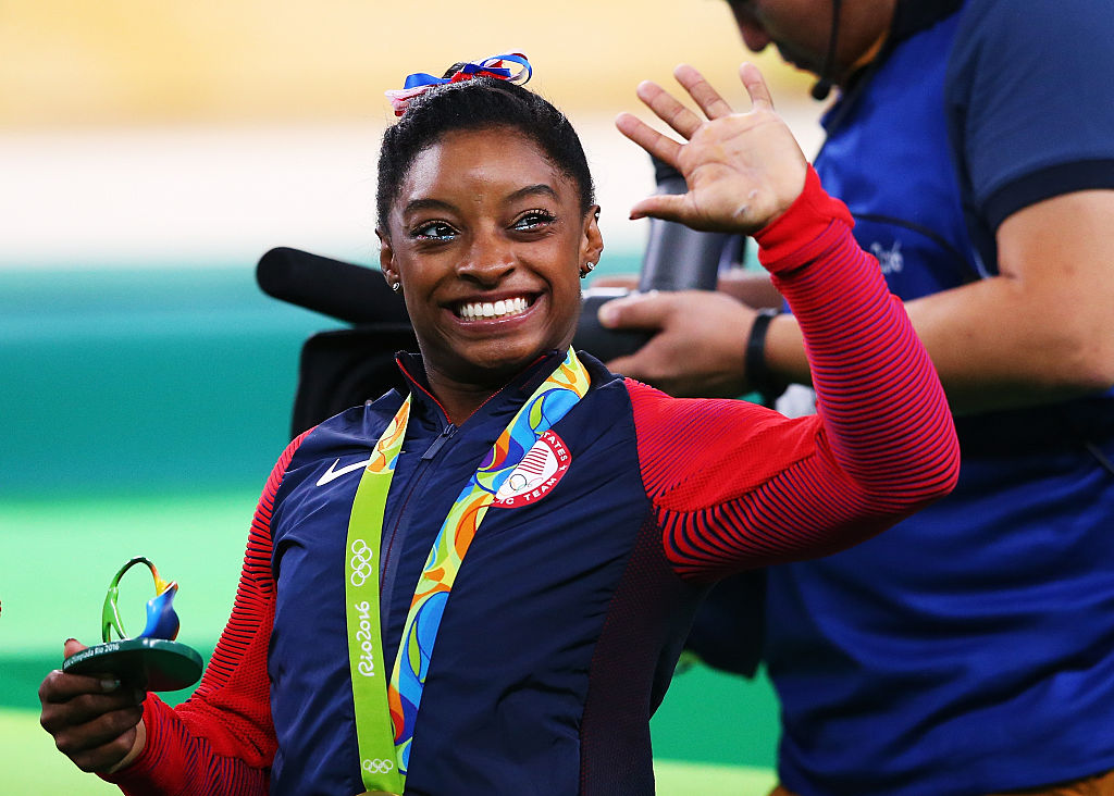simone biles getting a gold medal