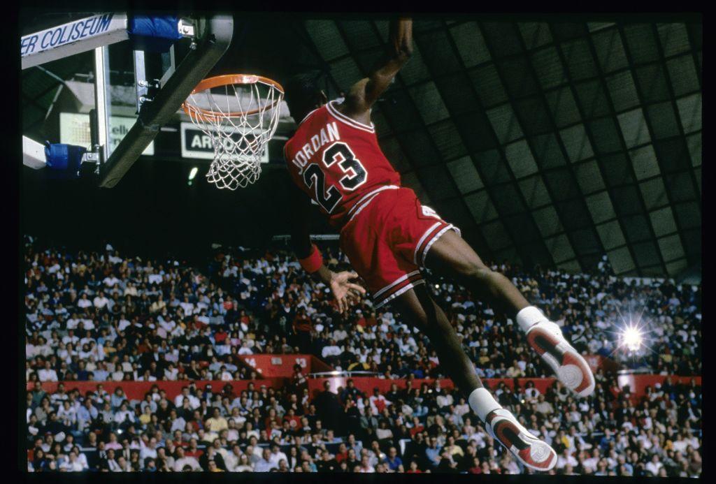 Michael Jordan #23 of the Chicago Bulls goes for the slam dunk