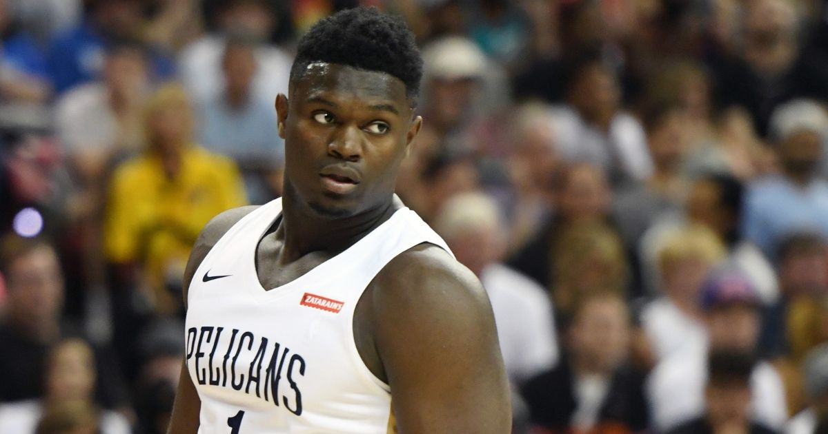 Zion Williamson wears his Pelicans jersey on the court