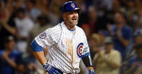 David Ross #3 of the Chicago Cubs reacts after scoring a run in the second inning of a game against the Cincinnati Reds