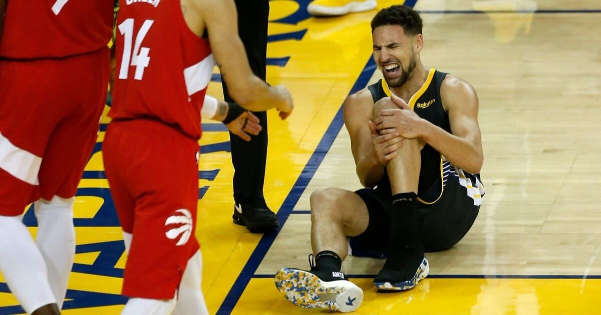 Klay Thompson  reacts after hurting his leg against the Toronto Raptors in the second half during Game Six of the 2019 NBA Finals
