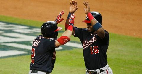 Adam Eaton #2 of the Washington Nationals is congratulated by his teammate Victor Robles #16 after hitting a two-run home