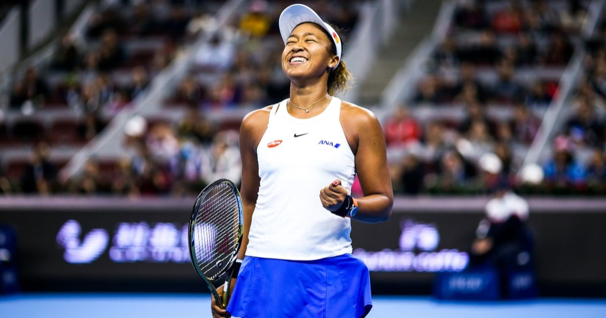 Naomi Osaka of Japan celebrates victory after the Women's Singles final match against Ashleigh Barty of Australia on Day nine of 2019 China Open