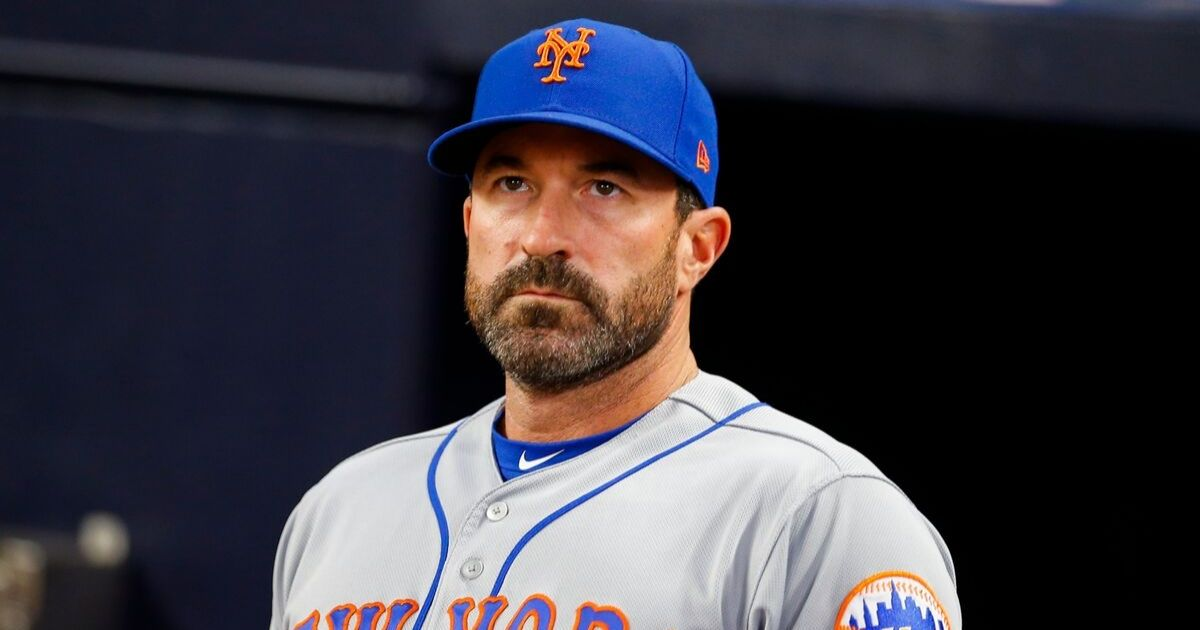 Manager Mickey Callaway of the New York Mets looks on before the seventh inning of an MLB game