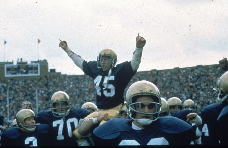 rudy being carried off the field by teammates
