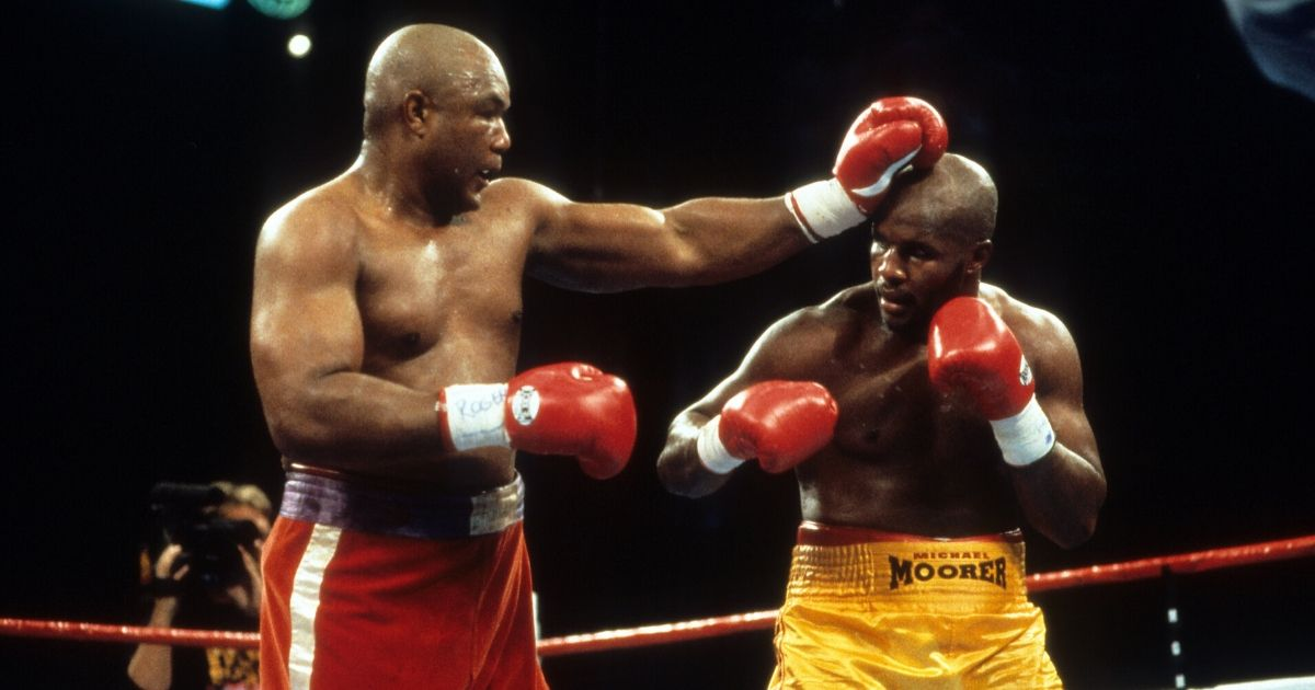 Michael Moorer (R) is hit with a punch from George Foreman during the fight at MGM Grand in Las Vegas, Nevada.