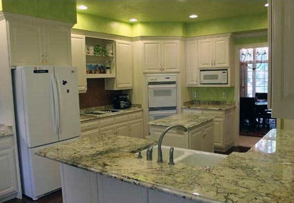 Facing the kitchen sink, you can see the side of the kitchen that leads into the formal dining room.