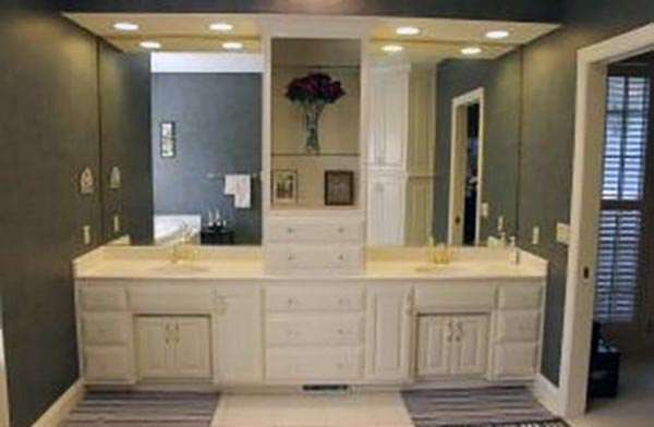 His and her sinks are separated by cabinetry in the master bathroom.