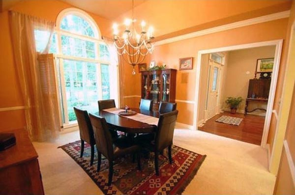 Off of the foyer is a dining room with a large window facing the front yard.