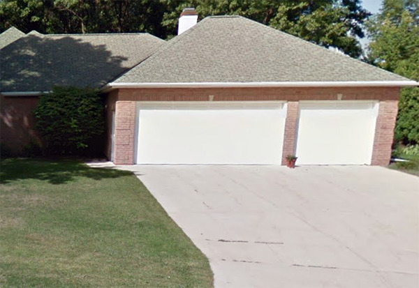 A three-car garage is at the home's right side.