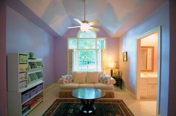 A playroom has a large window facing the yard and an adjoining bathroom.