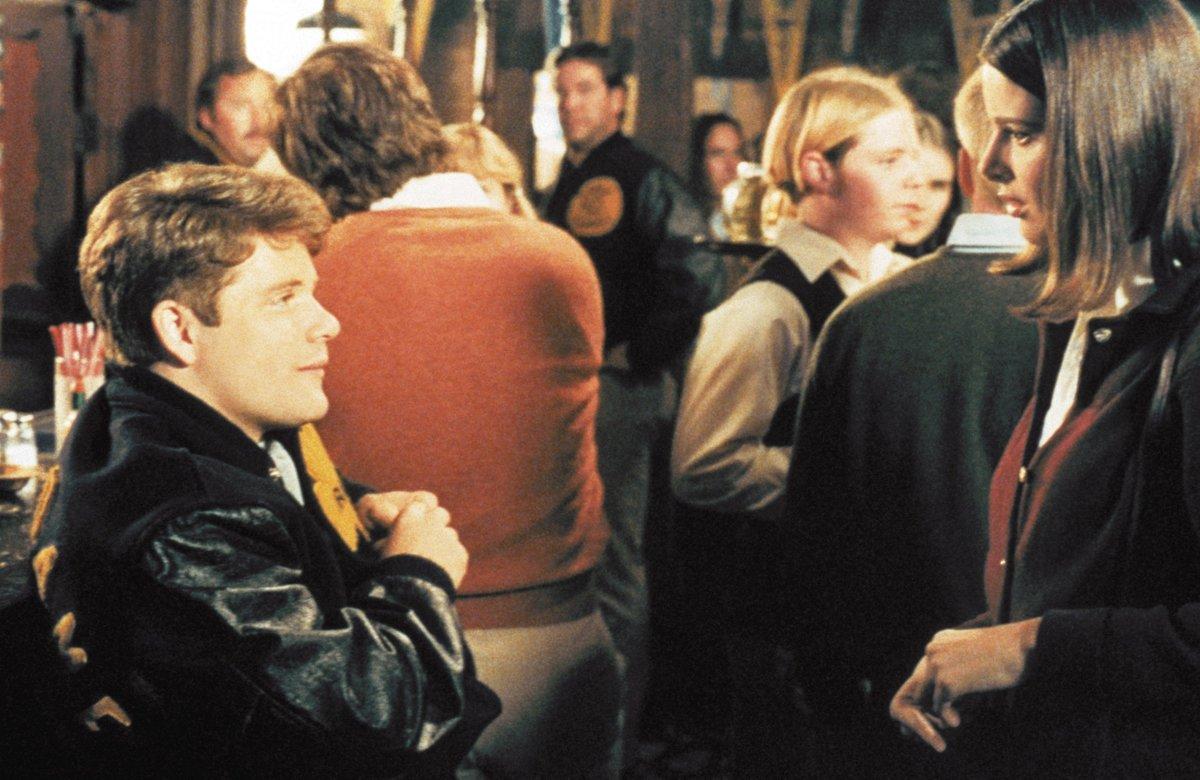 rudy at a bar flirting with a woman