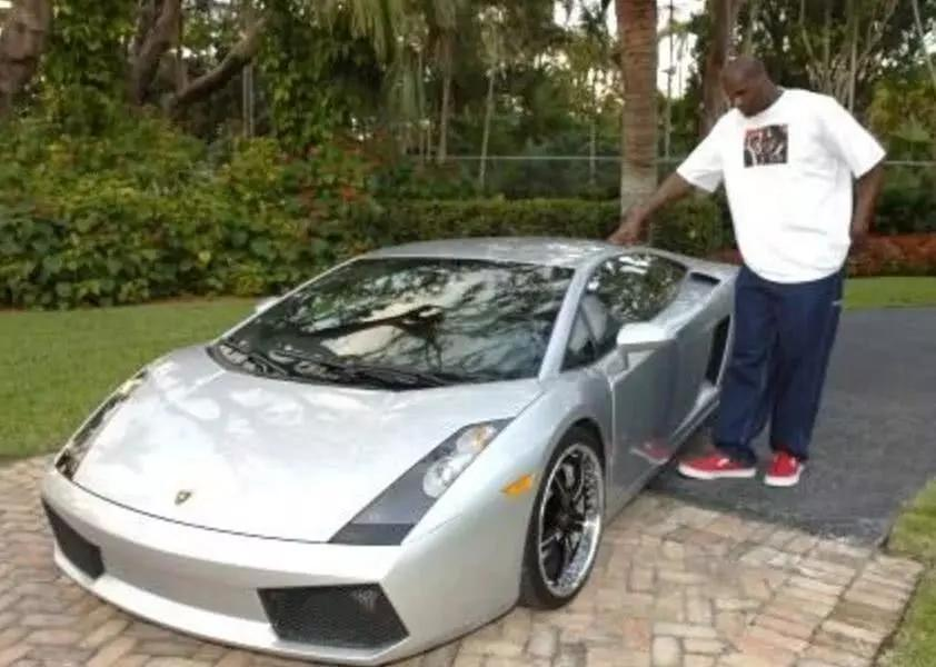 Shaq towers over his Lambo.