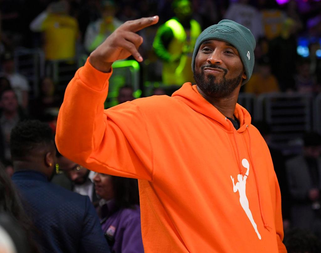 kobe byrant in an orange sweatshirt