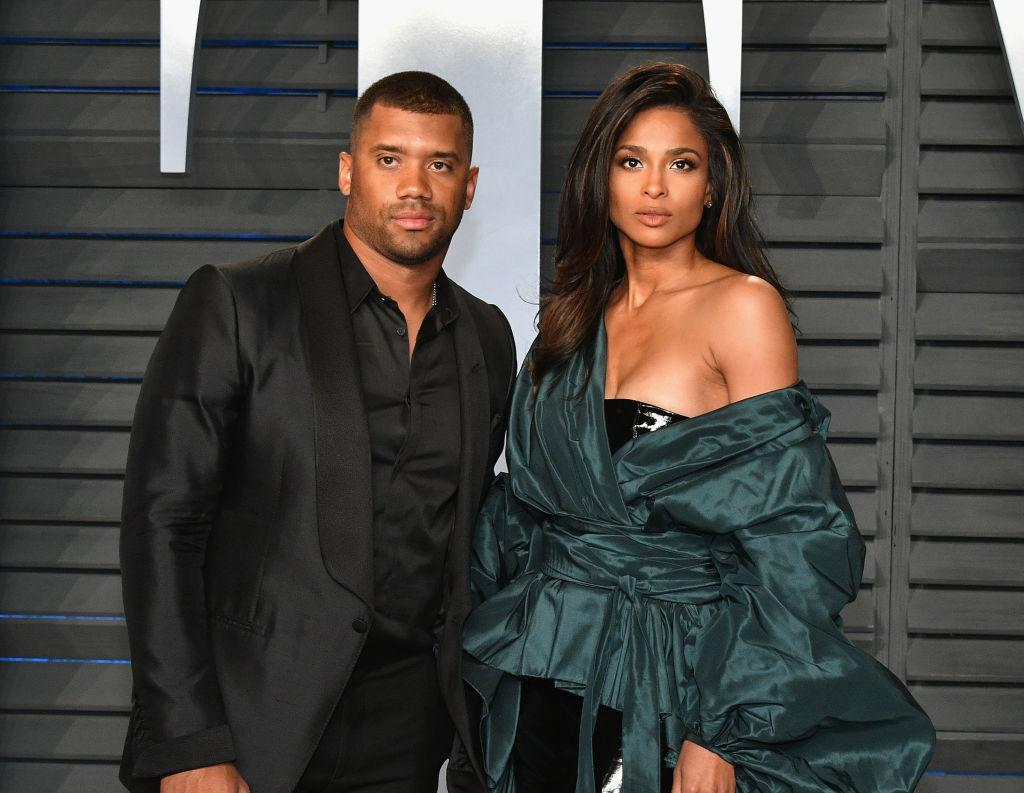 russell wilson with his wife Ciara