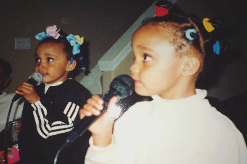 singing into mics