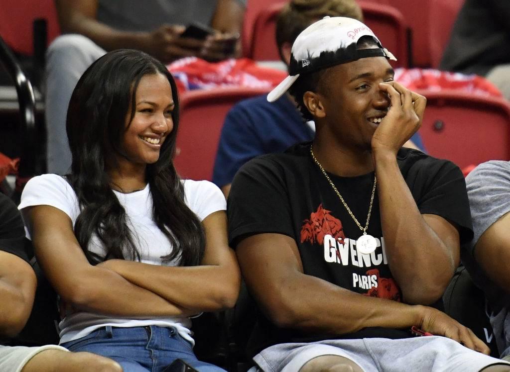 Deja Lighty (L) and Donovan Mitchell of the Utah Jazz laugh