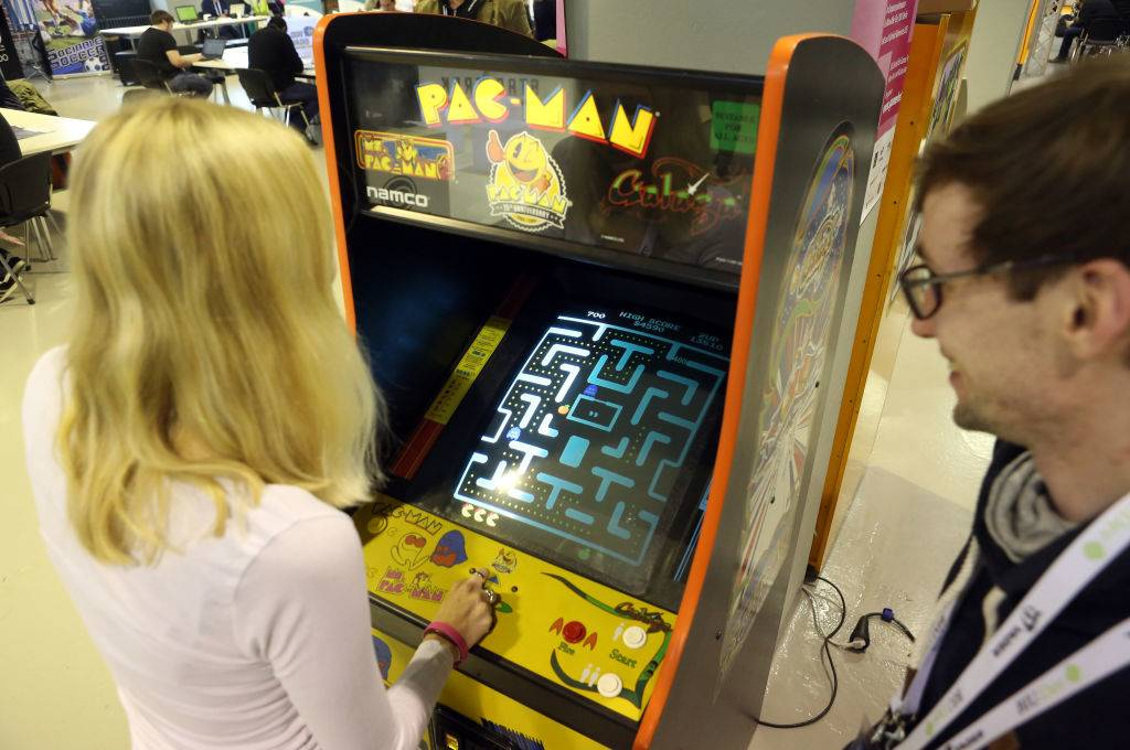 Visitor Alina Ullrich plays a vintage Pac-Man video game
