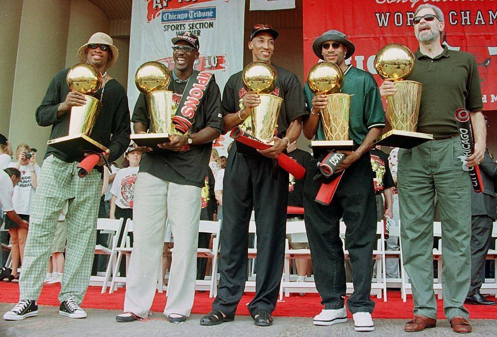 chicago bulls holding championship trophies