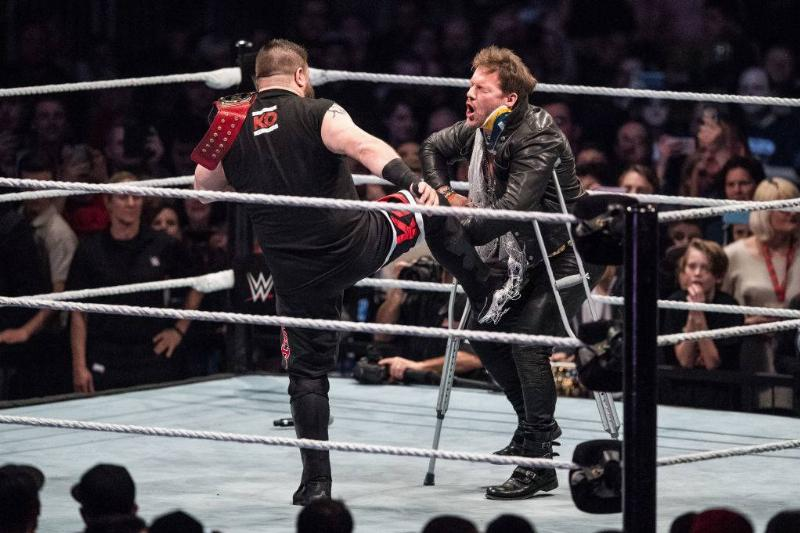 Chris Jericho (R) is attacked by Kevin Owens (L)