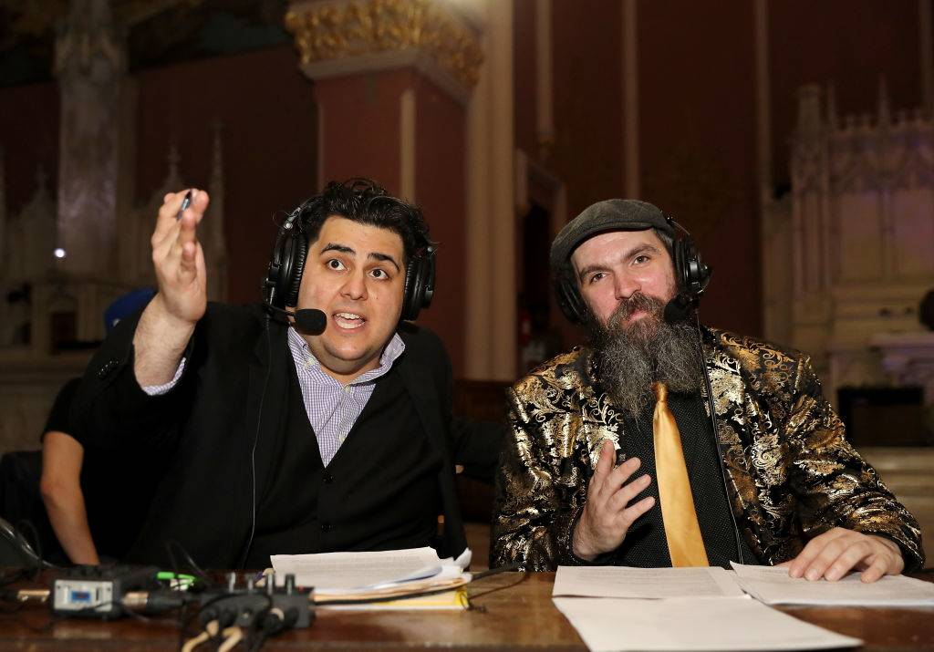 announcers at a wrestling match
