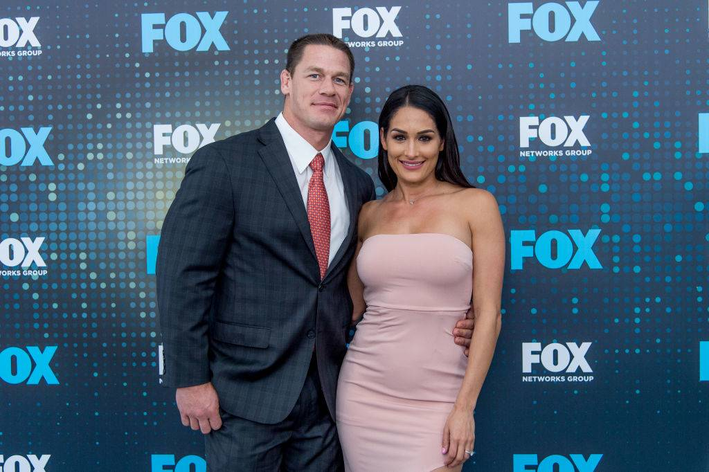 john cena and nikki bella posing for a photo
