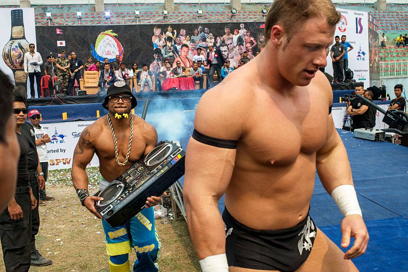 wrestler carrying a boombox