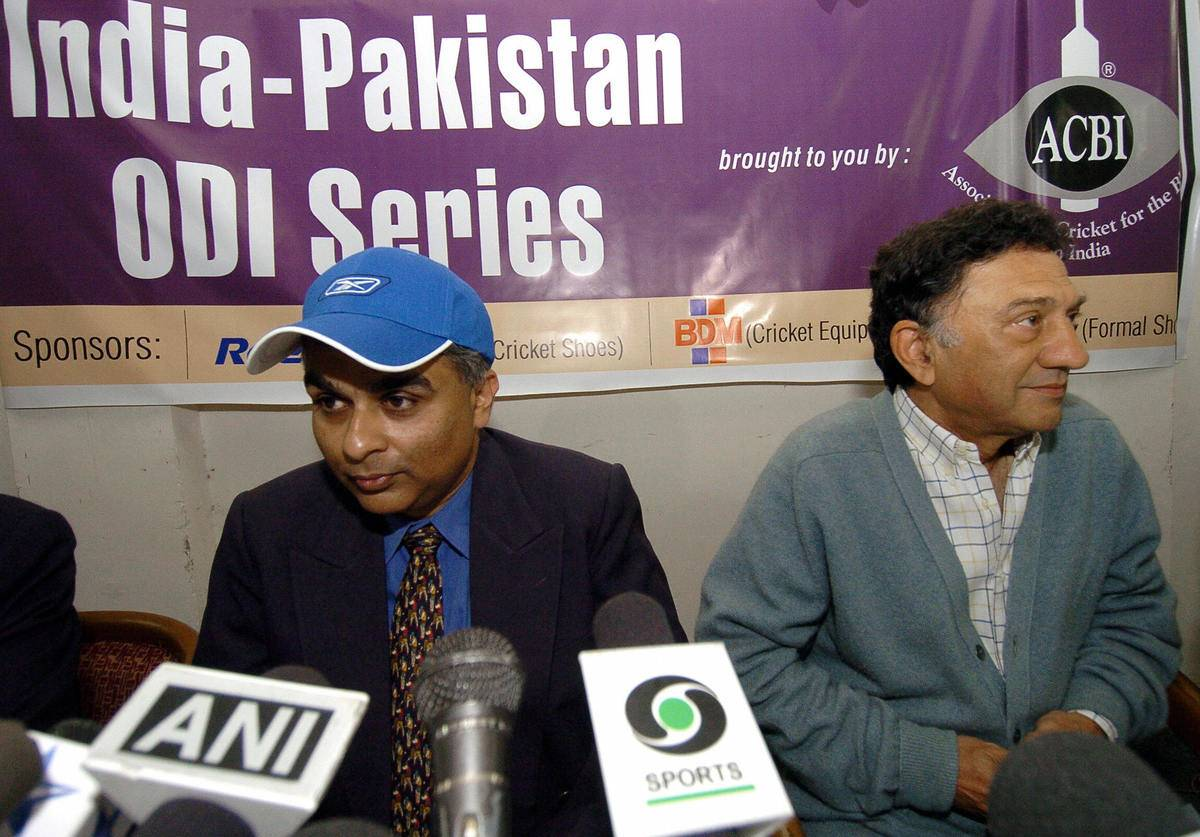 Chairman of Association for Cricket for the Blind in India (ACBI) George Abraham (L) and former Indian Test Cricketer Abbas Ali Baig (R) listen to reporters during a press conference.