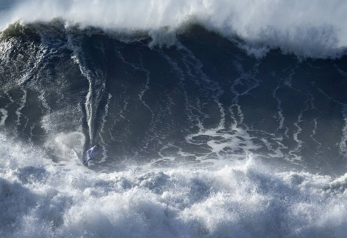 Big Wave Surfing by an extreme athlete