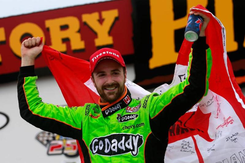 James Hinchcliffe holds up the Canadian flag while celebrating his victory in the Iowa Corn Indy 250.