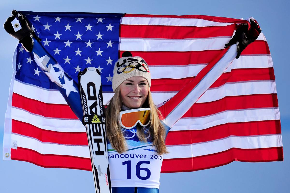 Lindsey Vonn shows off the United States flag after winning the gold medal during the 2010 Winter Olympics.