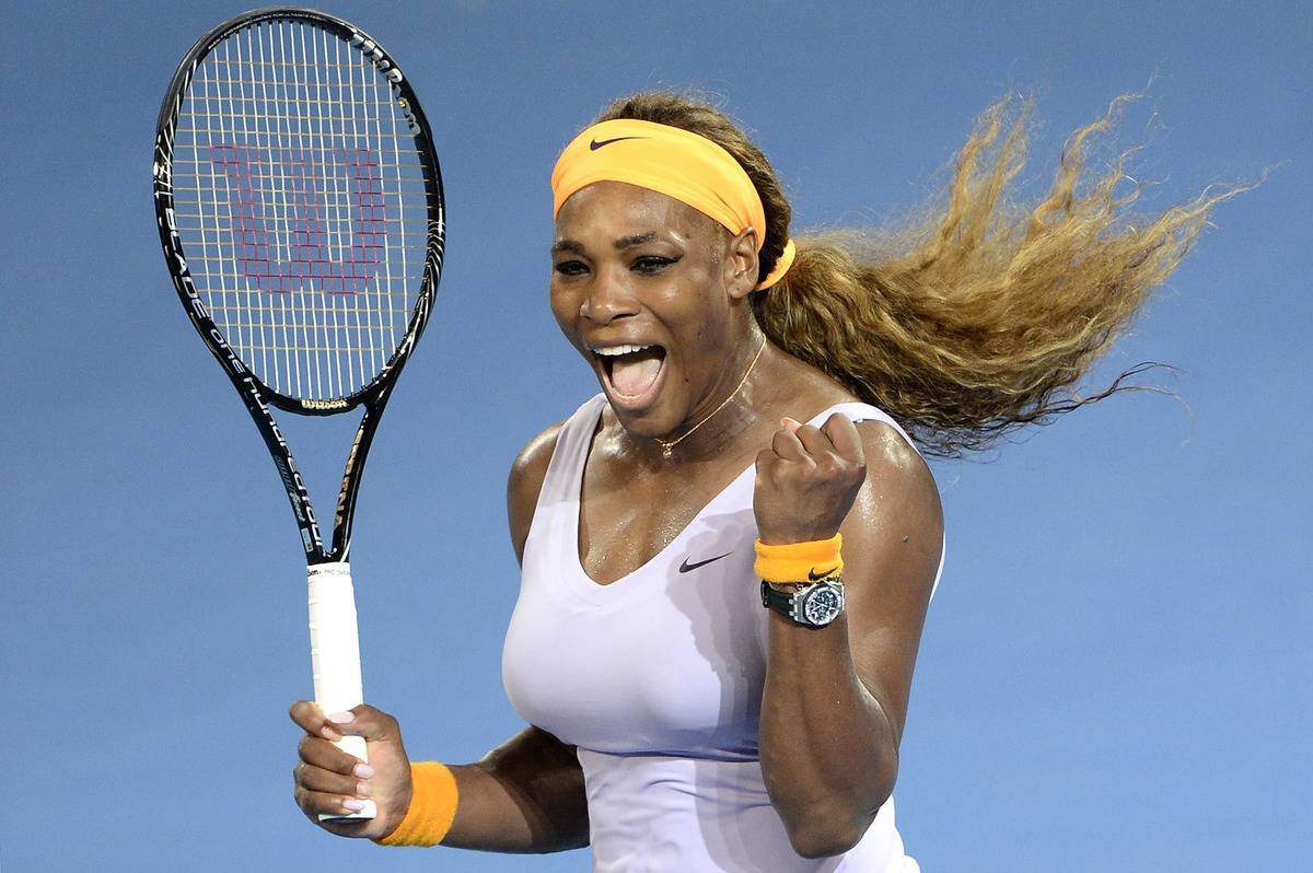 Serena Williams celebrates her victory during day seven of the 2014 Brisbane International.
