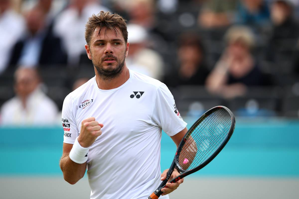 Stan Wawrinka holds up a fist in celebration after scoring a point during the Fever-Tree Championships, 2019.